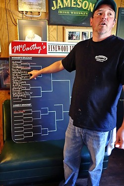 INSTIGATOR!:  McCarthy's bartender and race organizer Patty Kirby fills out the bracket in the double elimination races. - PHOTO BY GLEN STARKEY