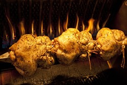 CRISPY SKIN :  The rotisserie in the kitchen is used not only for perfectly roasted chickens, but also for pork roasts.