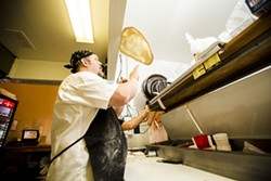 THE PIE MAN:  Michael Stevens owns Palo Mesa Pizza, where he puts his own spin on the menu. - PHOTO BY HENRY BRUINGTON