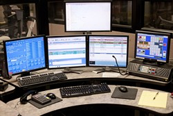COMMAND CENTRAL:  On any given night, there are two to four dispatchers with the San Luis Obispo County Sheriff's Department stationed at consoles just like this one. - PHOTO BY STEVE E. MILLER