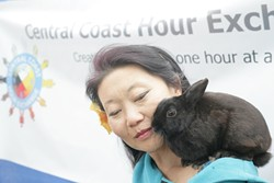 HOUR EXCHANGE WANTS YOU! :  Briana Shean and her little bunny Bartholomew explain all about the Central Coast Hour Exchange. - PHOTO BY GLEN STARKEY