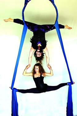 GOOD VERSUS EVIL:  Mirilith (Stephanie Bailey, top) and Luna (Alex Milaychev, bottom) fight out an age-old battle … in the air! - PHOTO BY SUSPENDED MOTION AERIAL ARTS