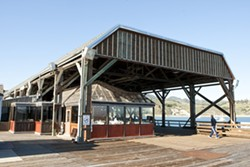 THINGS FALL APART :  After 20 years, the historic canopy at the end of the Hartford Pier in Avila Beach is still in disrepair, but fixing it without bankrupting businesses is a complicated and expensive problem. - PHOTO BY STEVE E. MILLER