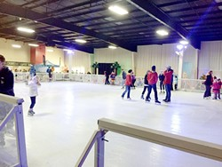 SKATING IN A WINTER WONDERLAND:  The young and old alike ventured out the day after Christmas to catch some fleeting holiday magic at the Winter WonderSLO ice skating rink. - PHOTO BY RYAH COOLEY