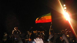 RASTA COLORS :  The flag man kept the Ethiopian emblem flying high for the whole show. - PHOTO BY NICK POWELL