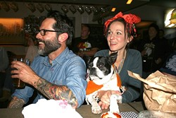 "LAUGH TRACK:  Atascadero locals Greg Cherry and Joey Bell laugh out loud while ""bar dog"" Jack watches, un-amused. - PHOTO BY HAYLEY THOMAS"