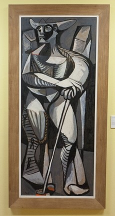 STANDING COWBOY :  This painting by Channing Peake, rancher and fine artist, reflects both an interest in Cubism and reverence for the cowboy figure, which he depicts as having near-mythic proportions. - PHOTOS BY STEVE E. MILLER