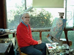 """AN HONOR :  Octogenarian multi-genre artist Chet Hill exhibits decades of oil paintings at La Perla del Mar Chapel in Shell Beach through March 12, with an opening reception on Feb. 27 from 6:30-8:30 p.m. The exhibit and sale will be open on Feb. 28 from 10:30-4:30 p.m. La Perla is located at 205 Windward Ave in Shell Beach. Hill's artwork covers every inch of wall space at his Arroyo Grande home. His home studio '""""is everything I want."""" Hill's collectors include Foo Fighters' guitarist Chris Shiflett. The cathedral pictured was painted after Hill's eyesight took a turn for the worse over 12 years ago. Info: LaPerlaDelMarChapel.com or 748-5547. - PHOTO BY CHRISTY HERON"""