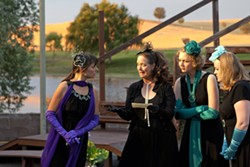 WHAT TIDINGS?:  The princess of France (Heather MacLeod-Schultz, far left), eagerly listens to a piece of news brought by her de facto messenger Boyet (Janet Stipicevich, letter in hand) while fellow ladies in waiting Rosaline (Claire Harlan, second from right) and Katharine (Angela Hutt-Chamberlin, far right) listen in. - PHOTO BY STEVE E. MILLER
