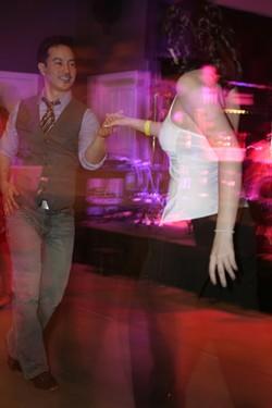 DANCING DJ :  Cal Poly Salsa Club member and DJ Chance Siri shows off his dance skills. - PHOTO BY GLEN STARKEY