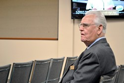 HANGING UP ON GOD :  Pismo Beach City Chaplain Dr. Paul Jones—pictured here at a Nov. 5, 2013, Pismo Beach City Council meeting—is now the former chaplain, as council members voted to eliminated the chaplain position as part of a settlement in a public prayer lawsuit brought against the city last year. - FILE PHOTO BY RHYS HEYDEN