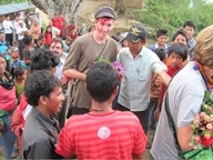 BACK TO SCHOOL :  Hands In Nepal has built one school in a remote mountain village and is in the process of constructing a second—a third is already on the way, too. Pictured is Danny Chaffin (the tall white guy), coordinating the second project with villagers. - PHOTO COURTESY OF JAN SPRAGUE CHAFFIN