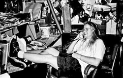 THEN:  Neal Losey kicks back in Cal Poly's student-run KCPR 91.3FM office in the early '90s. - PHOTO COURTESY OF NEAL LOSEY