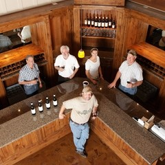 FRONT MAN :  Mike Sinor (center front) makes the wines at Ancient Peaks Doug Filipponi and Rob Rossi (from left) own the winery, along with Karl Wittstrom (right). Amanda Wittstrom, next to Karl, handles sales and marketing. - PHOTO BY STEVE E. MILLER