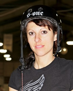 NAME: HILLFIRE:  AGE: 26 - OCCUPATION: hairstylist - NUMBER: x - POSITION: jammer - AVERAGE POINTS PER GAME: 50 - GAMES PLAYED: 10 - PHOTO BY STEVE E. MILLER