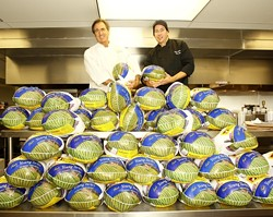 BIRD IS THE WORD :  Jose Dahan (left) and sous chef Jason Chenaux (right) of Et Voila were already preparing for Thanksgiving on Nov. 13 when a load of turkeys arrived at the restaurant. - PHOTO BY STEVE E. MILLER