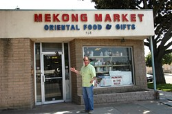 CHEF RICK'S FINE FIND :  Enthusaistic Chef Rick Manson outside the Mekong Market, which offers rare and interesting ingredients like frozen pig's blood, canned mud carp and ground dried fish by the pound . - PHOTO BY DAN HARDESTY
