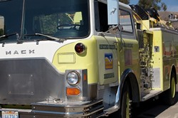 SIREN SONG :  Volunteers from local fire departments took an engine to Mexico as part of a series of donations to help combat blazes south of the border. - PHOTO BY JESSE ACOSTA