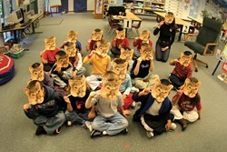LEARNING ABOUT LIONS :  Kindergarten students in Suzanne Nichols' class at Hawthorne School enjoy acting like mountain lions as part of their studies. - PHOTO BY CHRISTOPHER GARDNER