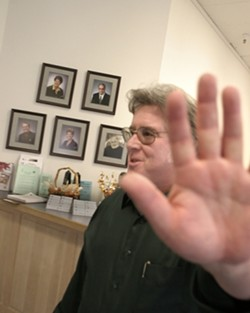 ON FILM :  Atascadero's besieged redevelopment chief, Marty Tracey, was reprimanded for putting his hand in front of his face in a photo for an Oct. 27, 2005, New Times cover story. - FILE PHOTO BY CHRISTOPHER GARDNER