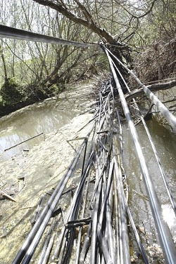 WRAPPED IN PLASTIC :  Local activists are concerned about trash and other pollutants found in Nipomo Creek and other local waterways. - PHOTO BY STEVE E. MILLER