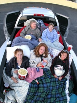 BEANBAGS IN PARADISE:  Eric and Becca Norrbom (in the back) brought nieces (left to right) Jessica and Christina Leahy and their friend Hannah Villegas to the drive-in, loading beanbag chairs in the back of a pickup. - CHRISTOPHER GARDNER