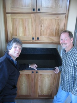 NATURES ART :  Locally grown sycamore, a relative of maple, was used by cabinetmaker Clark Kluver (right) for the cabinets in the Arroyo Grande home of Mike Geringer (left). - PHOTO BY KATHY JOHNSTON