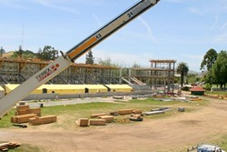 BUILD UP :  Construction at Cal Poly's Spanos Stadium displaced this year's graduation ceremonies. - PHOTO BY CHRISTOPHER GARDNER