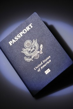 """TRAVELS WITH UNCLE SAM :  An emblem beneath the words """"United States of America"""" indicates that this passport, issued this past winter, contains RFID technology. - PHOTO BY STEVE E. MILLER"""