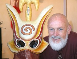 THE MAN AND HIS MASK:  Local mask maker Tim Beckwith created this otherworldly mask for a performance at the Los Angeles Craft and Folk Art Museum. - GLEN STARKEY