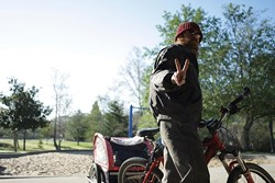 Brad flashes the peace sign as he departs for the Prado Day Center. The next day he sided with Mike in a decision not to frequent the center because of his dislike for handouts. - PHOTO BY STEVE E. MILLER