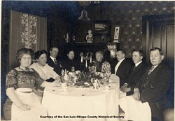 GUESS WHO IS COMING TO DINNER? :  The Sauer family of San Luis Obispo the Sauer Adobe across from the Mission is named after them sits down to a Thanksgiving Day dinner at the turn of the century.