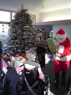 """ORNAMENTATION :  """"Be a Santa to a Senior"""" Christmas trees around the county feature ornaments with the names and gift requests of needy seniors. - PHOTO COURTESY OF HOME INSTEAD SENIOR CARE"""
