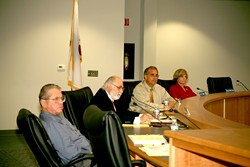 COUNCIL UNDER FIRE :  Councilmembers (left to right) Jerry Clay, George Luna, Tom O'Malley, and Becky Pacas—minus former mayor Wendy Scalise, who resigned citing health reasons—sat quietly as dozens of citizens lined up to share grievances during a council meeting on June 27. - PHOTO BY JESSE ACOSTA