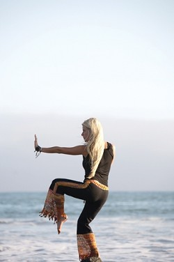WORKOUT WISE :  Nia instructor Calico Hauser offers body and nature friendly workouts at the beach. - PHOTO BY JESSE ACOSTA