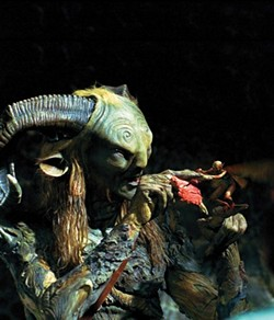 """EFFECTS UNDER ONE ROOF :  Getting the chance to create characters is a special effects companys dream come true. """"Any kind of character or creature of animation is very difficult to get awarded to an untried studio,"""" Visual Effects Producer Ed Irastorza said. Pictured is Doug Jones as The Faun, with one of the fairies created by Cafe FX. - PHOTO COURTESY OF PICTUREHOUSE ENTERTAINMENT"""
