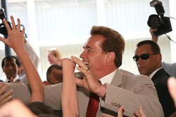 BIG MAN ON CAMPUS :  Republican incumbent Arnold Schwarzenegger greets a lively crowd of supporters at his June 14 appearance at San Luis Obispo's Sinsheimer Elementary. - PHOTO BY JESSE ACOSTA