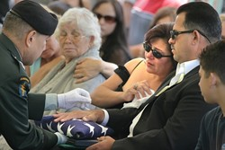 GRIEVING MOTHER AND FATHER :  On May 25, friends and family of Army Pfc. Michelangelo Mora — a 19-year-old Arroyo Grande resident killed in Iraq — gathered at his hometown cemetery where he was buried with full military honors. Mora, a scout in the 3rd Squadron, 2nd Armored Cavalry Regiment, 1st Cavalry Division, died in a Humvee accident during a mission near Najaf on May 14. He had been scheduled to return home on June 30.