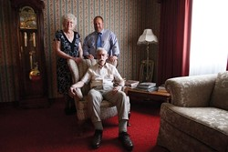 ALL IN THE FAMILY :  Undertaking is traditionally a family business. The Reis family--Irene, Gene (seated), and son Kirk--have operated their funeral home in SLO since 1955. - PHOTO BY STEVE E. MILLER