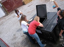IN THE LINE OF DUTY :  (l-r) Audrey Faber, Alyssa Tennant, Aubrey Wynn, and Caitlyn Arigo checked the quality of the vegetable oil at a storage bin in Gallup, N.M., to ensure that there's no shortening. - PHOTO COURTESY OF VEGGIE GIRLS