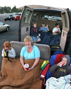 BIRTHDAY BASH:  The Slocum family along with some friends came to the drive-in to celebrate 10-year-old Randys (waving in the van) birthday. - CHRISTOPHER GARDNER
