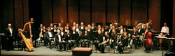 BLOW, BABY, BLOW :  The SLO Wind Orchestra opens its 2007-'08 season with a multi-faceted concert on Oct. 20 in the Trinity United Methodist Church in Los Osos. - PHOTO COURTESY OF SLO WIND ORCHESTRA