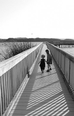YOUNG EXPLORERS :  *****strokes-book-8/3***** - Valerie and Erica Best helped gather research for Best Family Adventures: San Luis Obispo County by taking a stroll on the Oso Flaco Lake boardwalk. - PHOTO COURTESY OF JENNIFER BEST