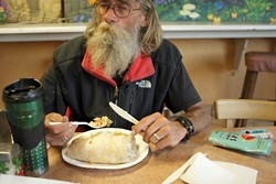 Once when Mike was quite hungry, he was met with generosity and kindness at Chili Peppers, so each month when he gets his disability check he goes to eat at the restaurant. Shrimp burritos and fish tacos are his favorite. - PHOTO BY STEVE E. MILLER