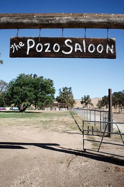 WELCOME TO POZO SALOON :  Concertgoers enter the outdoor venue through this portal, filing into the field to the left, which will be filled with upwards of 3,000 people when the Black Crowes play. - PHOTO BY STEVE E. MILLER