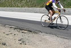 CRACKING ASPHALT:  An example of the faulty bike lane along highway 1. - BY CHRISTOPHER GARDNER