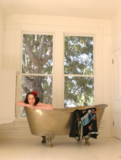 A CLEANSING EXPERIENCE Sanitarium staff member Heidi Harmon floats in a Moroccan bathtub that comes standard in every room. - CHRISTOPHER GARDNER