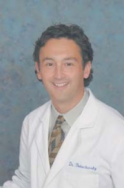 FACE TO FACE:  Dr. Roman Bukachevsky volunteers his time and expertise as a plastic surgeon to help victims of domestic abuse.