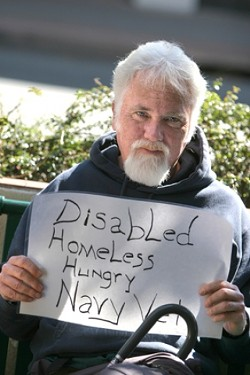 """BENCH TIME :  Homeless Navy veteran Patrick Walker agrees aggressive panhandling is wrong. """"I'm not a piece of furniture, I'd hate to be removed. It's a public bench on public property and I'm still a part of society. Many of us spilled blood to be on this bench.� The proposed ordinances target transients, but it's unclear how these new laws will affect the homeless population. - PHOTOS BY CHRISTOPHER GARDNER"""