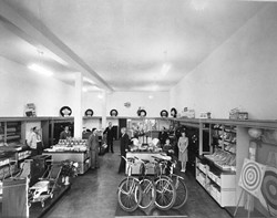 ALL IN THE FAMILY :  Tom Bello's parents planted the seed for Bello's Sporting Goods in 1945 by opening a B. F. Goodrich franchise. Gradually, they expanded into toys and other products. Tom Bello is the child in this photo. - PHOTO COURTESY OF TOM BELLO